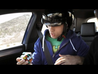 Volkswagen Golf R vs. Speed Rubik's Cuber