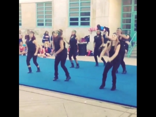My squad killed it at yesterday's pep rally. that's me in the middle all bent down getting crunk lol. i'm so proud of my girls!