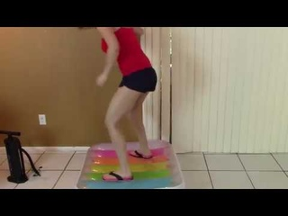 Brittany Lynn Barefoot Flip Flops Jumping Inflatable