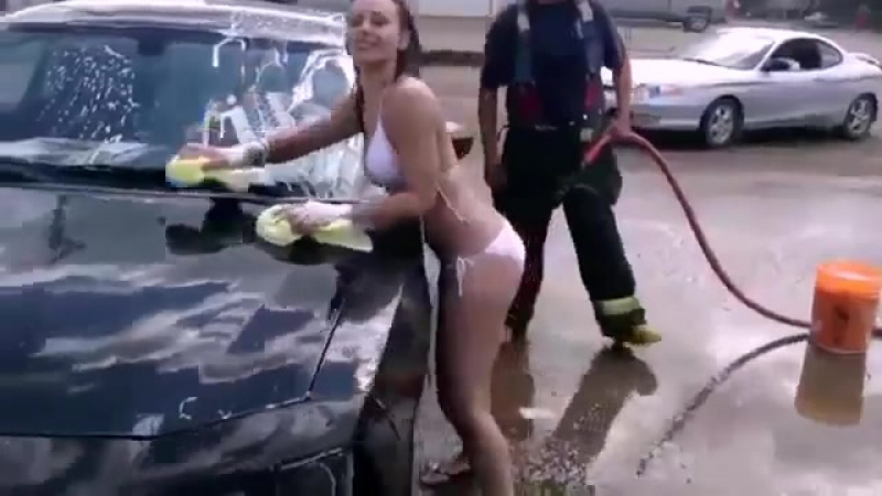 Girls in bathing suits, along with the fire brigade on