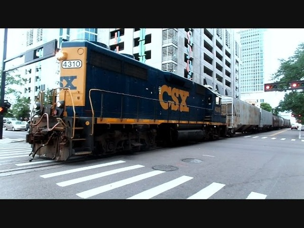 CSX Street Runner Freight Train In The Middle Of Downtown